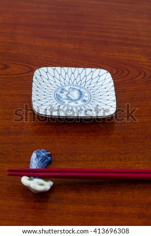 Japanese plate with chopsticks - stock photo