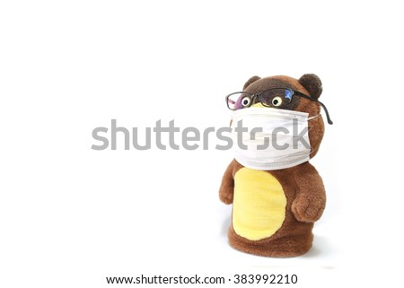 Japanese raccoon dog toy with hay fever - stock photo