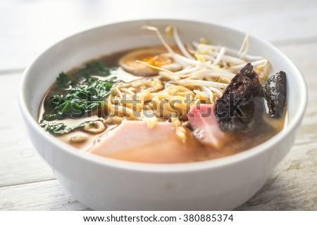 Japanese ramen bowl on wood background. Tasty japanese food - stock photo