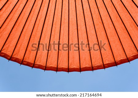Japanese red umbrella on the blue sky   - stock photo