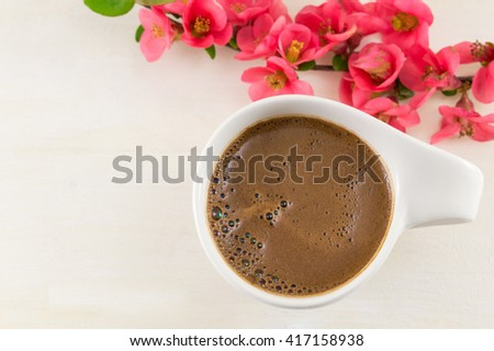 Japanese rose flowers and a cup of coffee