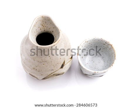 Japanese sake cup and bottle on white background