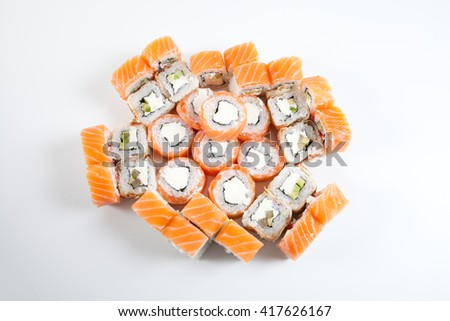 Japanese salmon rolls on a white background