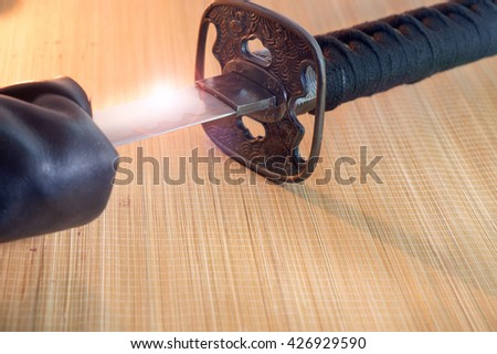 Japanese samurai sword and sheath on bamboo background.