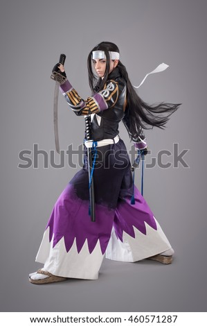 Japanese samurai with katana sword. Studio shoot. Isolated