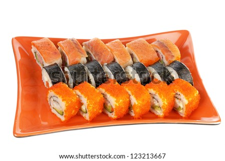Japanese seafood, rolls on a red plate