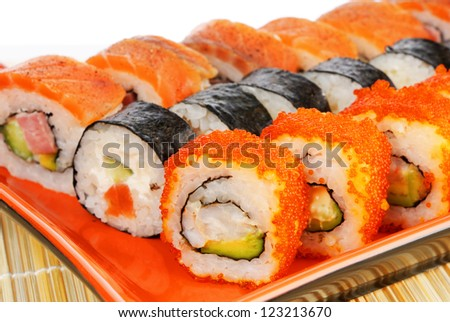 Japanese seafood, rolls on a red plate - stock photo