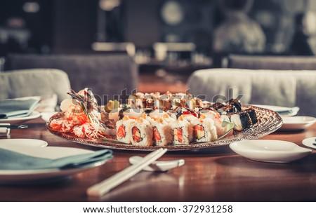 Japanese seafood sushi many tasty fresh Japanese sushi with tuna, caviar and shrimps - stock photo