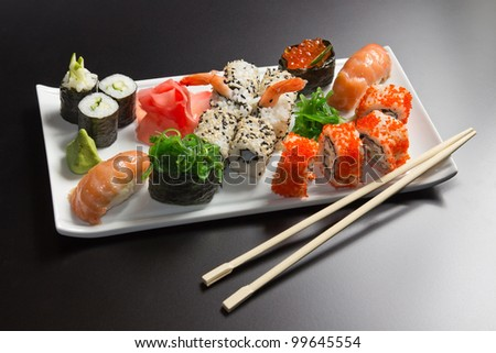 Japanese  seafood  sushi , roll and chopstick on a white plate - stock photo