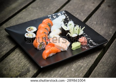 Japanese seafood sushi set on black background - stock photo