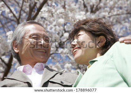 Japanese senior couple smiling each other
