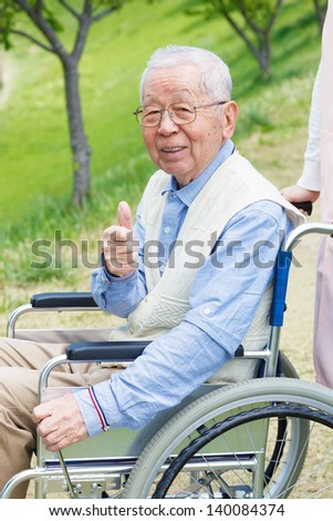 Japanese senior man in the field - stock photo