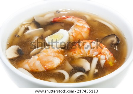 Japanese soup with prawns on a white background