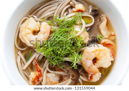 Japanese soup with shrimp and pasta in a restaurant - stock photo