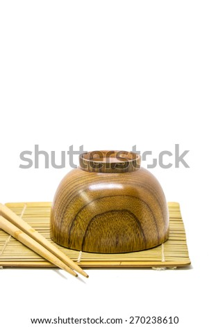 Japanese Soup wooden cup and chopsticks on white background - stock photo