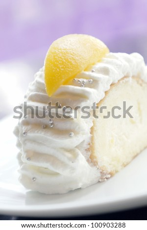 Japanese style fresh cream cake topped with peach fruit. - stock photo