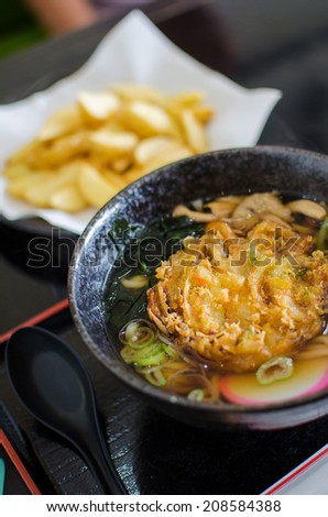 Japanese style noodle ramen with deep fried seafood - stock photo