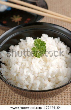 Japanese style sticky rice in a lacquer bowl  - stock photo