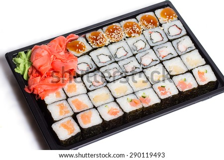 Japanese suisine. Sushi set in black plastic box isolated. Delivery service.