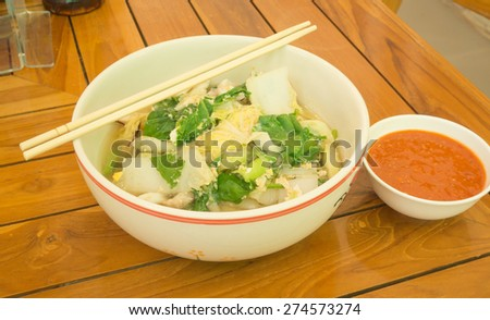 Japanese Sukiyaki with sauce on wooden table - stock photo