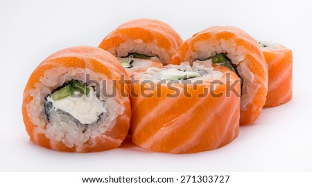 Japanese sushi and rolls Philadelphia classic made of fresh raw salmon isolated on a white background.
