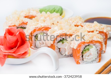 Japanese sushi salmon and crab meat with sauce (shallow DOF) - stock photo
