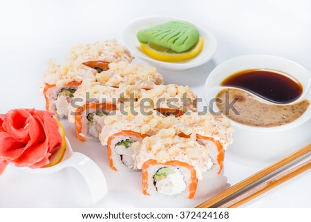 Japanese sushi salmon and crab meat with sauce (shallow DOF). ginger, wasabi and soy sauce - stock photo