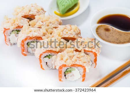 Japanese sushi salmon and crab meat with sauce (shallow DOF). wasabi and soy sauce - stock photo