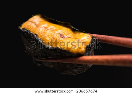 Japanese sushi sea urchin isolated on black background - stock photo