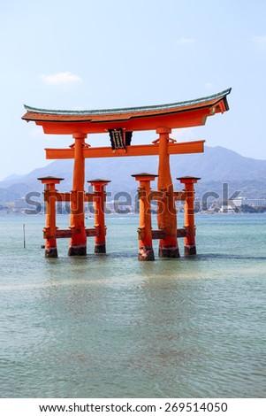 Japanese symbol - the sacred red torii at high tide. Miyajima Island (Itsukushima), Japan - stock photo