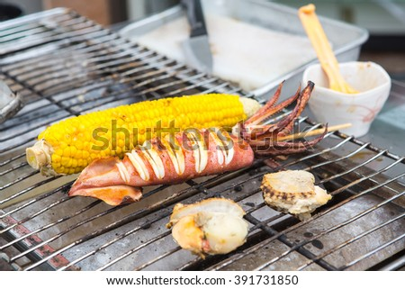 Japanese tasty street and fast food: grilled squid, corn and shellfish - stock photo