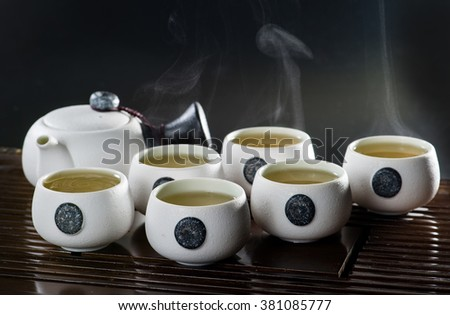 Japanese tea cup with hot tea and steam