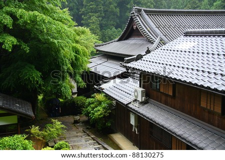 Japanese temple in the green forest (countryside near Kyoto) - stock photo
