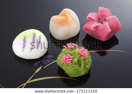 "Japanese traditional confectionery cake"" wagashi"" on lacquered plate - stock photo"