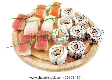Japanese traditional Cuisine - Maki Roll with Cucumber , Cream Cheese and Raw Salmon inside served with Nigiri topped raw Salmon Tuna and Eel . Isolated over white background - stock photo