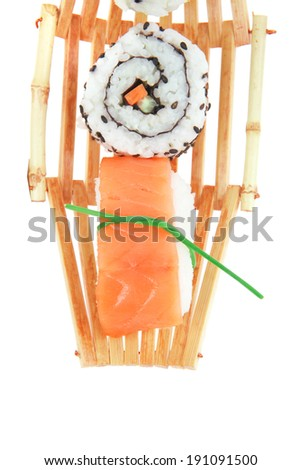 Japanese traditional Cuisine - Roll with Cucumber , Cream Cheese and Raw Salmon inside. Sashimi topped Smoked Salmon and raw Eel . Isolated over white background - stock photo