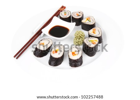Japanese traditional Cuisine - Roll with Cucumber , Cream Cheese with raw Tuna(maguro) and Salmon(sake) inside. on white dish with sticks isolated over white background