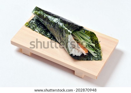 Japanese traditional cuisine-Sushi temaki on wooden plate isolated over white background-2 - stock photo