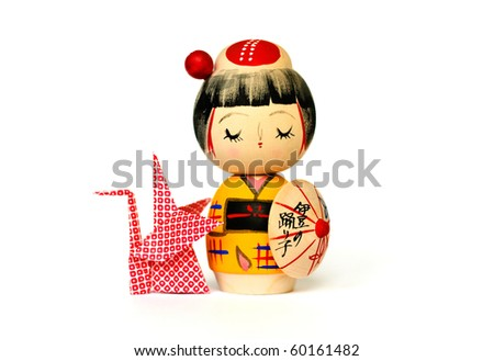 japanese traditional doll and origami isolated