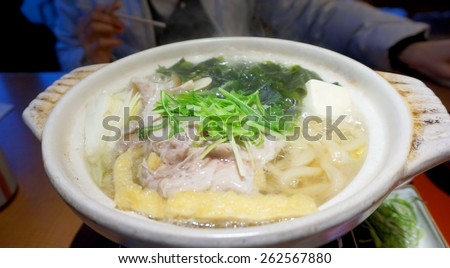 Japanese udon hot pot prok with vegetable and seaweed - stock photo