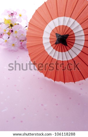 japanese umbrella and cherry blossom on pink background - stock photo