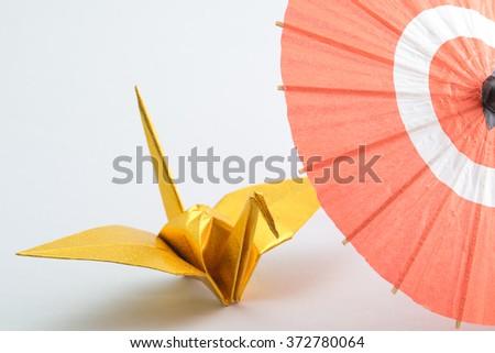 Japanese umbrella and origami - stock photo