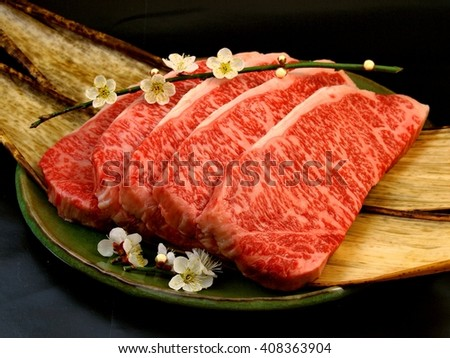 Japanese Wagyu Beef steak cuts with plum flower. - stock photo