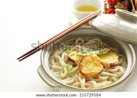 Japanese winter cuisine, sweet potato Tempura and Udon with green tea on background - stock photo