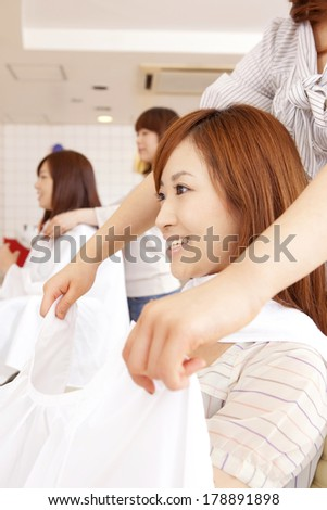 Japanese woman and hairdresser in hair salon