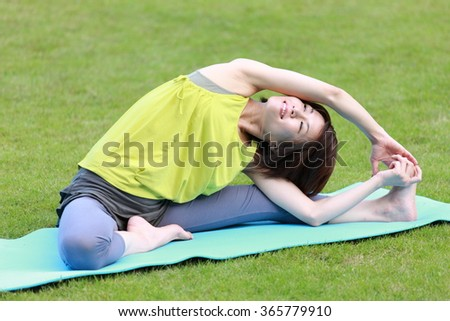 Japanese woman doing stretch