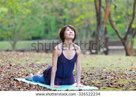 "Japanese Woman Doing YOGA ""cobra pose"""
