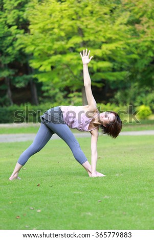 "Japanese Woman Doing YOGA ""revolved triangle pose"""