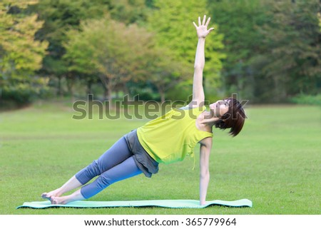 "Japanese Woman Doing YOGA ""Side Plank pose"" - stock photo"
