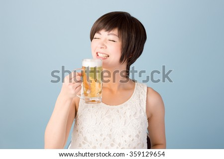 Japanese woman drinking a draft beer